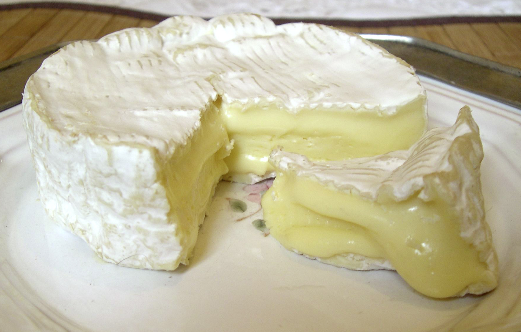 Camembert Cheese (AOC) has a pale yellow, runny interior.