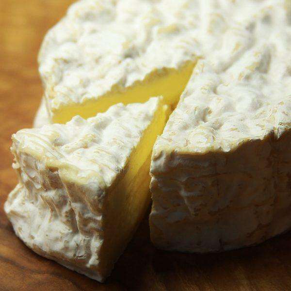 A close up of Camembert De Normandie AOC Cheese